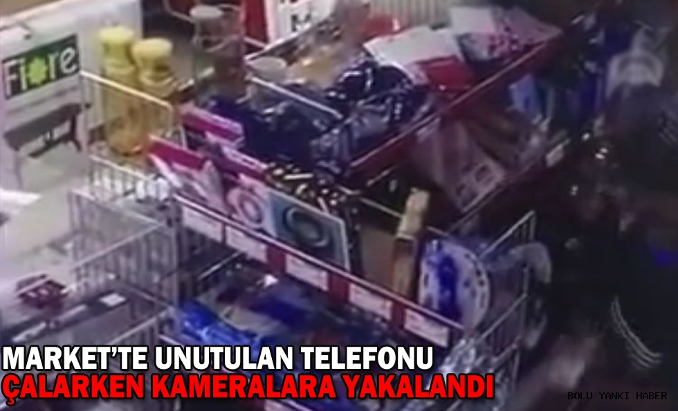 MARKET'TE UNUTULAN TELEFONU ÇALARKEN KAMERALARA YAKALANDI