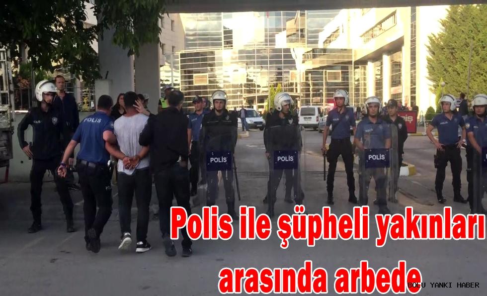 Polis ile şüpheli yakınları arasında arbede